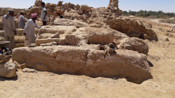This undated photo released by the Egyptian Ministry of Antiquities, shows workers examining the remains of a temple dating back to the second century, in the country's western desert, some 50 km west of Siwa Oasis, Egypt. The ministry said Thursday, May 10, 2018, that the temple, dates back to the reign of Roman Emperor Antoninus Pius. (Egyptian Ministry of Antiquities via AP)