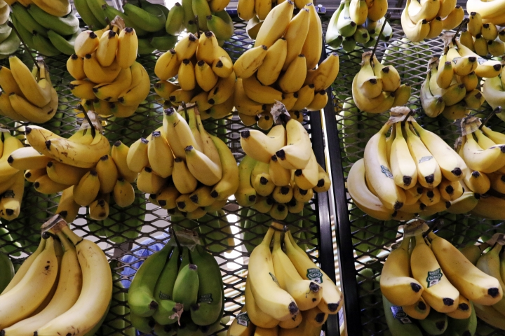 This May 3, 2017 file photo shows bananas for sale at a Whole Foods Market in Upper Saint Clair, Pa. U.S. wholesale prices edged up just 0.1 percent in April 2018 held down by a big drop in food costs. It was the smallest gain in four months. The April increase in the Labor Department's producer price index, which measures inflation pressures before they reach consumers, followed a 0.3 percent rise in March, the government reported Wednesday, May 9. (AP Photo/Gene J. Puskar)