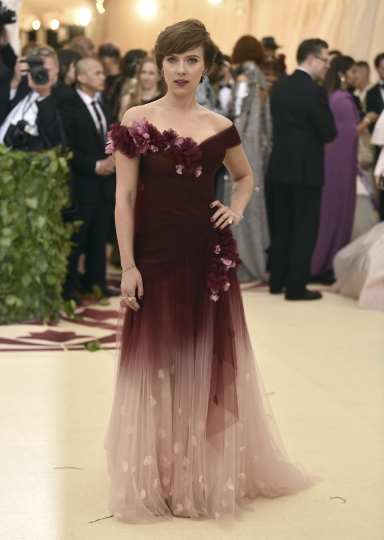 """FILE - In this May 7, 2018 file photo, Scarlett Johansson wears a Marchesa gown at The Metropolitan Museum of Art's Costume Institute benefit gala in New York. Marchesa co-founder Georgina Chapman, Harvey Weinstein's estranged wife, has given a tearful interview in Vogue magazine which she says she never knew of her husband's misconduct. The interview comes a day after Wintour came out in support of Chapman on Stephen Colbert's late-night show, """"Late Night with Stephen Colbert"""" and a few days after Johansson wore a gown by Marchesa at the Met Gala. (Photo by Evan Agostini/Invision/AP, File)"""