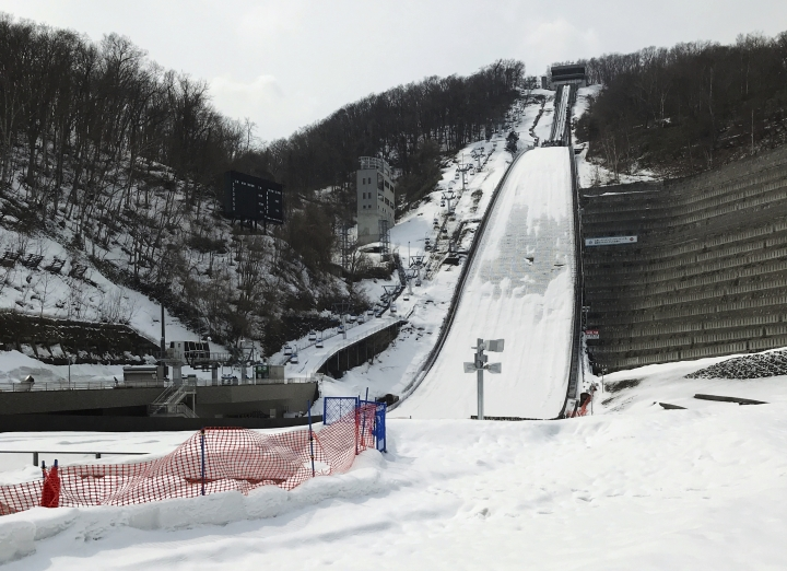 In this April 8, 2018 photo, the Okurayama Ski Jump Stadium, where ski jump competitions of the Winter Olympics in 1972 took place, is seen in Sapporo, northern Japan. The Japanese city of Sapporo seems to be having second thoughts about bidding for the 2026 Winter Olympics and could focus instead on the 2030 Games. (AP Photo/Ken Moritsugu)