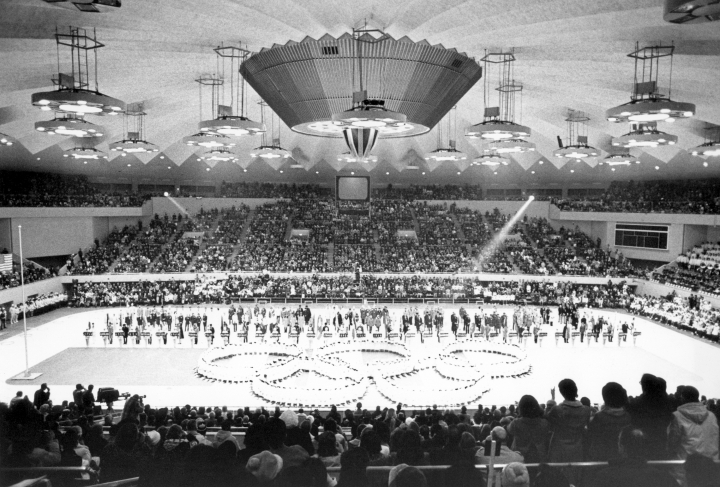 FILE - In this Feb. 13, 1972, file photo, Olympic rings in the center of the Makomanai ice arena is seen during the closing ceremony of the Winter Olympics, in Sapporo, Japan. The Japanese city of Sapporo seems to be having second thoughts about bidding for the 2026 Winter Olympics and could focus instead on the 2030 Games. (AP Photo)