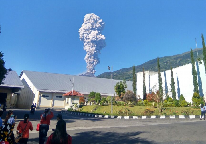 Mount Merapi spews volcanic materials from its crater as seen from Klaten, Central Java, Indonesia, Friday, May 11, 2018. Indonesia's most active volcano, Mount Merapi, has erupted, sending a column of volcanic materials as high as 5,500 meters (18,045 feet) into the sky. (AP Photo/Muhammad Amin)