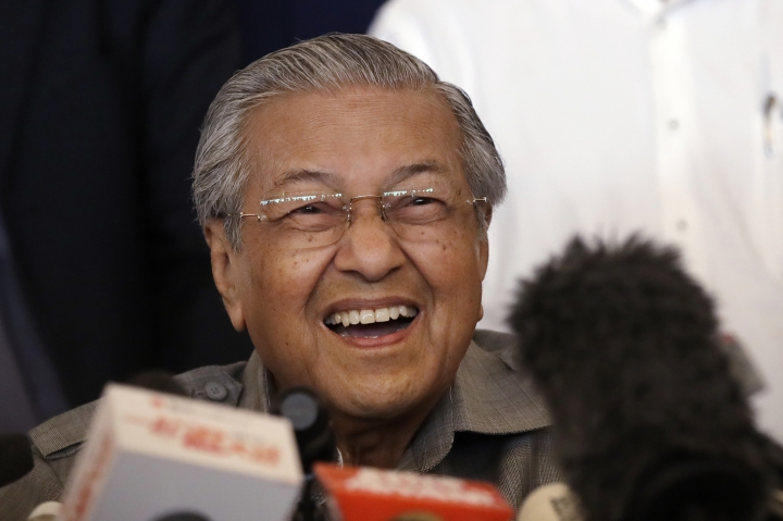 Mahathir Mohamad reacts as he speaks during a press conference in Kuala Lumpur, Malaysia, Thursday, May 10, 2018. Mahathir says the opposition parties who won a shock victory in Malaysia's elections have a clear mandate to form a new government and he expects to be sworn in as prime minister on Thursday. (AP Photo/Andy Wong)