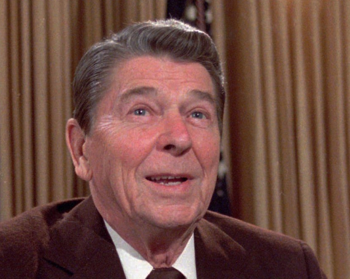 FILE - In this May 24, 1985, file photo, then U.S. President Ronald Reagan works at his desk in the oval office of the White House as he prepares a speech on tax revision. Age has long been an issue for politicians. Reagan faced plenty of questions about his mental abilities when he ran for U.S. president in 1980, and he was just 69 years old. Now Mahathir Mohamad, 92, is Malaysia's newest prime minister. It's been 37 years since Mahathir first had the job, and 15 since he retired from it. (AP Photo/Scott Stewart, File)