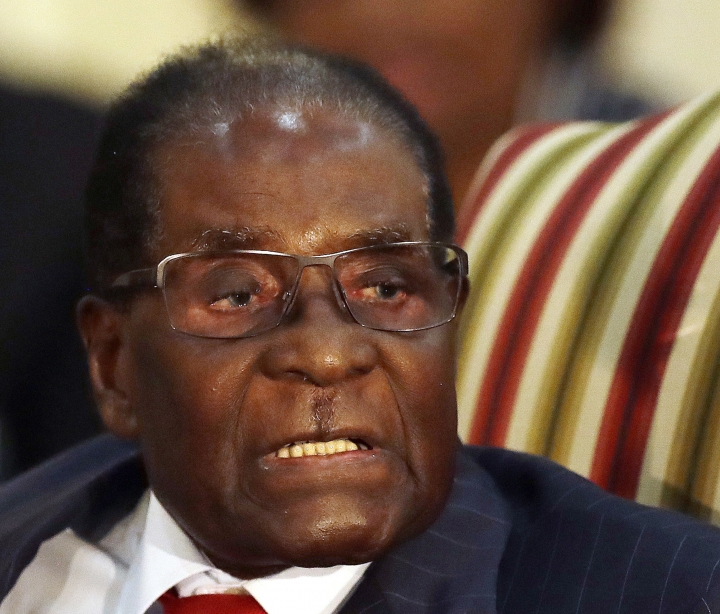 """FILE - In this Oct. 3, 2017, file photo, then Zimbabwean President Robert Mugabe sits during a meeting with South African President Jacob Zuma in Pretoria, South Africa. Age has long been an issue for politicians. Mugabe was ridiculed as Zimbabwe's """"dinosaur,"""" a man consumed by greed and power who refused to give way to a younger generation, until being pushed out at age 93. Now Mahathir Mohamad, 92, is Malaysia's newest prime minister. It's been 37 years since Mahathir first had the job, and 15 since he retired from it. (AP Photo/Themba Hadebe, File)"""