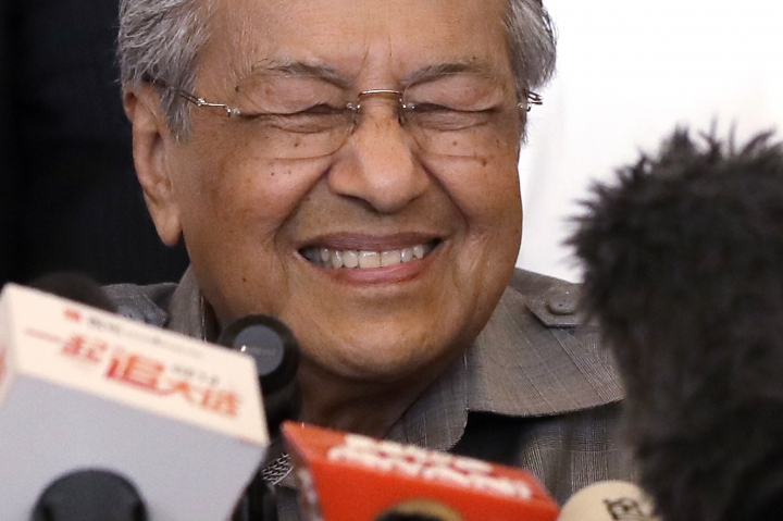In this Thursday, May 10, 2018, file photo, Mahathir Mohamad reacts as he speaks during a press conference at a hotel in Kuala Lumpur, Malaysia. Mahathir said the opposition parties who won a shock victory in Malaysia's elections have a clear mandate to form a new government and he expects to be sworn in as prime minister on Thursday. (AP Photo/Andy Wong, File)