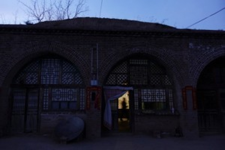 The exterior of a villager Li Caidong's cave dwelling is pictured at dusk in Lin county, Shanxi province, China March 14, 2018. REUTERS/Joseph Campbell