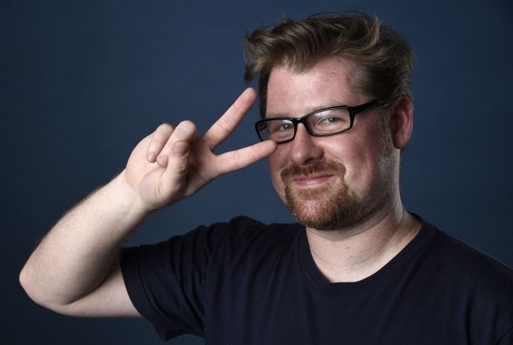 "FILE - In this July 21, 2017 file photo, Justin Roiland poses for a portrait to promote the television series ""Rick and Morty"" on day two of Comic-Con International in San Diego. Roiland posted on Instagram on Thursday, May 10, 2018, that 70 more episodes of ""Rick and Morty"" have been approved for the Cartoon Network's Adult Swim late-night programming. There were 31 episodes in its first three seasons. The series, which debuted in 2013, follows mad scientist Rick Sanchez and his grandson Morty Smith. (Photo by Chris Pizzello/Invision/AP)"