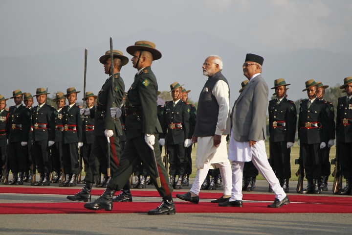 Indian Prime Minister Narendra Modi walks with his Nepalese counterpart Khadga Prasad Oli as he inspects a joint military guard of honour in Kathmandu, Nepal, Friday, May 11, 2018. Modi began a two-day visit to Nepal Friday as the two South Asian nations work to improve relations that were strained over Indian-backed ethnic protests in Nepal in 2015. (AP Photo/Niranjan Sherestha)