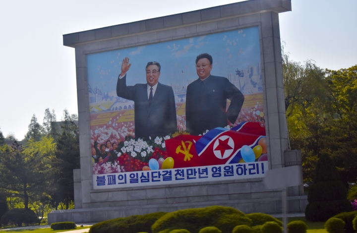 Portraits of late leaders Kim Il Sung, left, and Kim Jong Il, left, are seen along the motorcade route transporting Secretary of State Mike Pompeo and US diplomats in Pyonyang, North Korea, Wednesday, May 9, 2018. It began with quiet words from State Department officials: Apply for a new passport immediately. You may soon be going to a country for which ordinary U.S. passports are not valid for travel. (AP Photo/Matthew Lee, Pool)