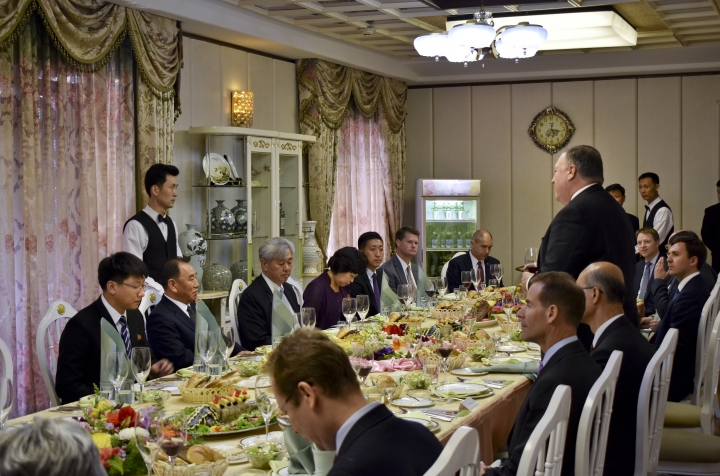 Secretary of State Mike Pompeo, right, stands as he speaks during a dinner between North Korean dignitaries and US diplomats, Pyonyang, North Korea on Wednesday, May 9, 2018. It began with quiet words from State Department officials: Apply for a new passport immediately. You may soon be going to a country for which ordinary U.S. passports are not valid for travel. (AP Photo/Matthew Lee, Pool)