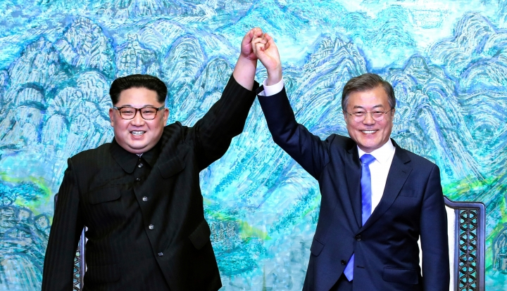 FILE - In this April 27, 2018, file photo, North Korean leader Kim Jong Un, left, and South Korean President Moon Jae-in raise their hands after signing a joint statement at the border village of Panmunjom in the Demilitarized Zone. Moon has stepped into the spotlight as he drives a new global push to settle the nuclear standoff with Pyongyang. (Korea Summit Press Pool via AP, File)