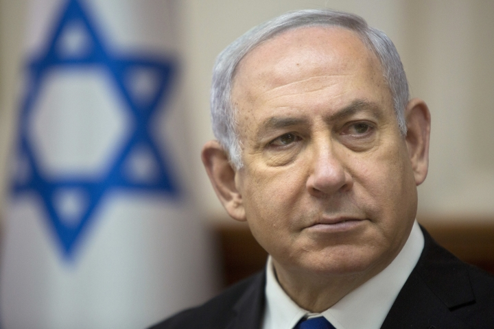 In this April 29, 2018 file photo, Israeli Prime Minister Benjamin Netanyahu arrives for a weekly cabinet meeting at the Prime Minister's office in Jerusalem, Sunday. A recent bout of dinner diplomacy between Israel's prime minister and a prominent Emirati ambassador illustrates one of the worst kept secrets in the Arab world: quiet ties between Israel and its Sunni Arab neighbors that are increasingly coming into the open. (AP Photo/Sebastian Scheiner)