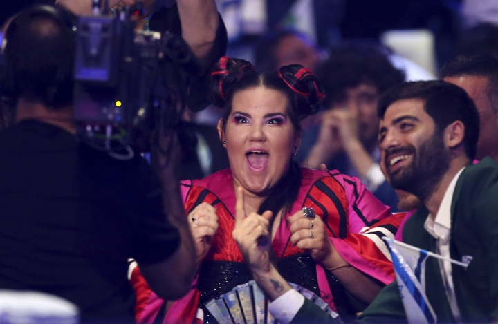 Netta from Israel reacts during the announcement of a voting in Lisbon, Portugal, Saturday, May 12, 2018 during the Eurovision Song Contest grand final. (AP Photo/Armando Franca)