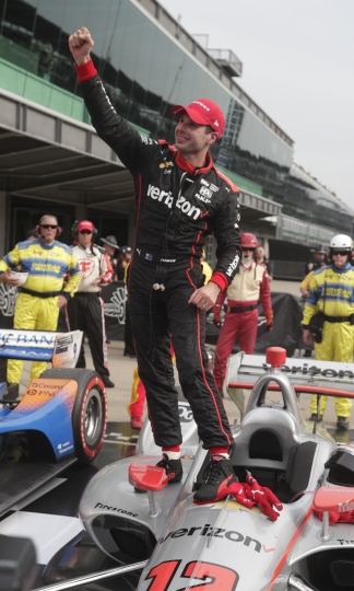 Will Power, of Australia, celebrates after winning the IndyCar Grand Prix auto race at Indianapolis Motor Speedway on Saturday, May 12, 2018, in Indianapolis. (AP Photo/Michael Conroy)