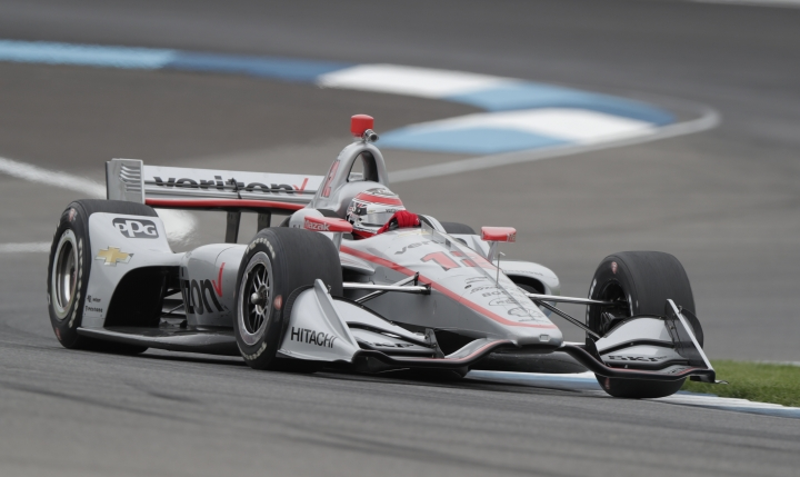 Will Power, of Australia, drives through a turn during the warm up session for the IndyCar Grand Prix auto race at Indianapolis Motor Speedway in Indianapolis, Saturday, May 12, 2018. (AP Photo/Michael Conroy)