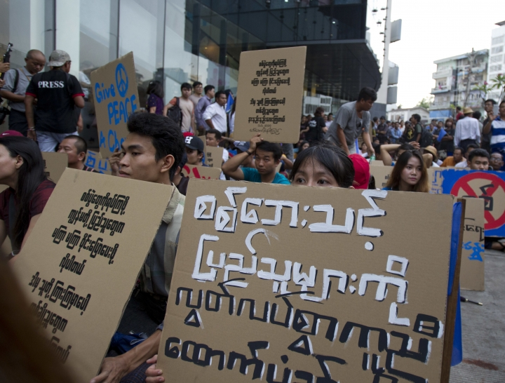 Activists hold placards demanding peace and help for war victims as they shout slogans during a rally for peace Saturday, May 12, 2018, Yangon, Myanmar. Myanmar police have cracked down on demonstrators and arrested many activists Saturday who made a rally for peace movement in Yangon. (AP Photo/Thein Zaw)