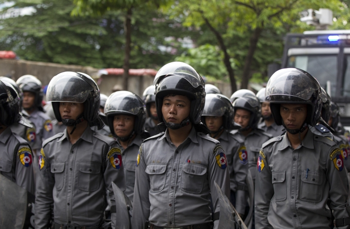 Riot police stand in position to block activists during a peace rally Saturday, May 12, 2018, Yangon, Myanmar. Myanmar police have cracked down on demonstrators and arrested many activists Saturday who made a rally for peace movement in Yangon. (AP Photo/Thein Zaw)