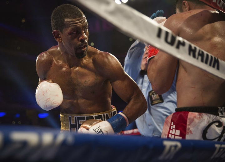 Jamel Herring keeps Juan Pablo Sanchez on the ropes during their lightweight boxing bout Saturday, May 12, 2018, in New York. (AP Photo/Kevin Hagen)