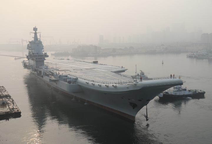 In this photo provided by China's Xinhua News Agency, China's aircraft carrier leaves Dalian in northeast China's Liaoning Province for sea trials Sunday, May 13, 2018. China's first entirely home-built aircraft carrier has begun sea trials in a sign of the growing sophistication of the country's domestic arms industry. State media said the still-unnamed ship left dock in the northern port of Dalian early Sunday, and the Liaoning provincial maritime safety bureau issued an order for shipping to avoid a section of ocean southeast of the city between Sunday and Friday. (Li Gang/Xinhua via AP)