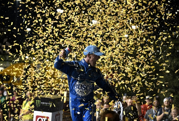 Kevin Harvick celebrates after winning the NASCAR Cup Series auto race at Kansas Speedway on Saturday, May 12, 2018, in Kansas City, Kan. (AP Photo/Ed Zurga)