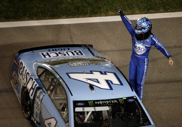 Kevin Harvick (4) celebrates after winning the NASCAR Cup Series auto race at Kansas Speedway on Saturday, May 12, 2018, in Kansas City, Kan. (AP Photo/Charlie Riedel)