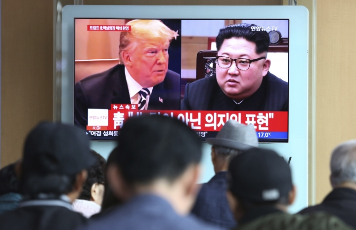 "People watch a TV screen showing file footage of U.S. President Donald Trump, left, and North Korean leader Kim Jong Un during a news program at the Seoul Railway Station in Seoul, South Korea, Sunday, May 13, 2018. North Korea said Saturday that it will dismantle its nuclear test site in less than two weeks, in a dramatic event that would set up leader Kim Jong Un's summit with President Donald Trump next month. Trump welcomed the ""gracious gesture."" (AP Photo/Ahn Young-joon)"