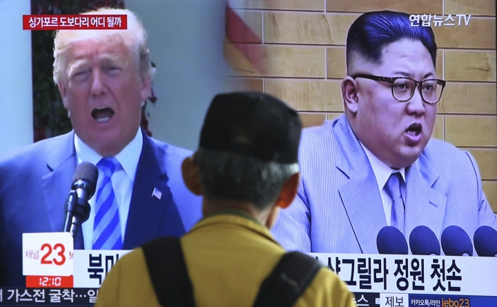 "A man watches a TV screen showing file footage of U.S. President Donald Trump, left, and North Korean leader Kim Jong Un during a news program at the Seoul Railway Station in Seoul, South Korea, Sunday, May 13, 2018. North Korea said Saturday that it will dismantle its nuclear test site in less than two weeks, in a dramatic event that would set up leader Kim Jong Un's summit with President Donald Trump next month. Trump welcomed the ""gracious gesture."" (AP Photo/Ahn Young-joon)"