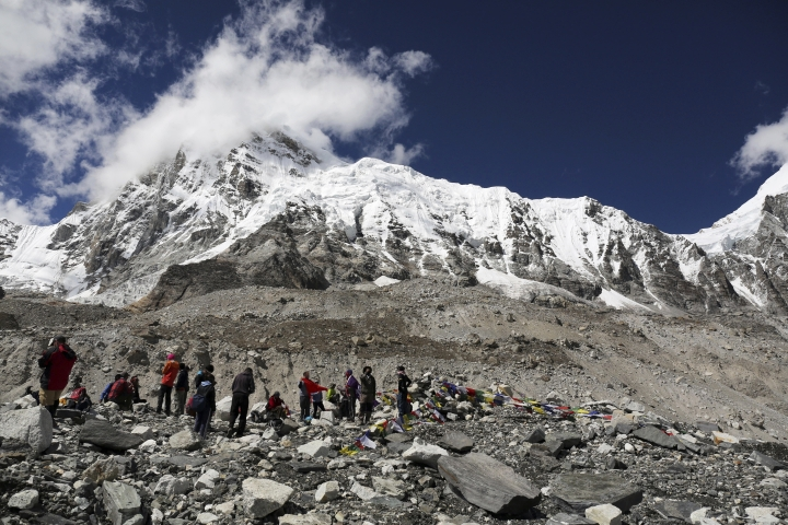 FILE - In this Sept. 27, 2015 file photo, trekkers rest at Everest Base Camp, Nepal. A group of Nepalese Sherpa guides has reached the summit of Mount Everest, fixing ropes and clearing paths for other climbers to begin their ascent to the peak. Tourism Official Gyanendra Shrestha says eight Sherpa guides were successful in reaching the summit on Sunday. (AP Photo/Tashi Sherpa, File)