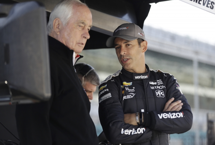 Helio Castroneves, right, of Brazil, talks with Roger Penske before a practice session for the IndyCar Grand Prix auto race at Indianapolis Motor Speedway, in Indianapolis Friday, May 11, 2018. (AP Photo/Darron Cummings)