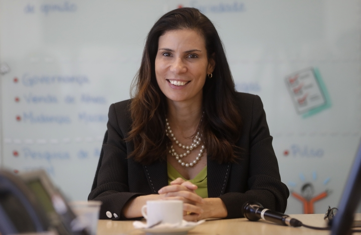 """In this April 12, 2018 photo, Olga Pontes, chief compliance officer at construction company Odebrecht, smiles during an interview with The Associated Press at the company's headquarters in Sao Paulo, Brazil. """"We have only one chance to change, and to change definitively,"""" said Pontes(AP Photo/Andre Penner)"""