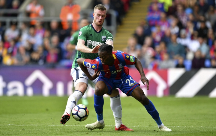 Crystal Palace's Aaron Wan-Bissaka, right, and West Bromwich Albion's Chris Brunt battle for the ball during their English Premier League soccer match at Selhurst Park, London, Sunday, May 13, 2018. (Dominic Lipinski/PA via AP)