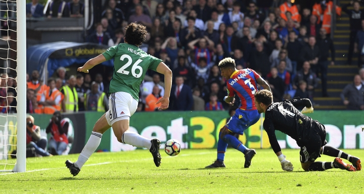 Crystal Palace's Patrick van Aanholt, center, scores his side's second goal of the game during their English Premier League soccer match against West Bromwich Albion at Selhurst Park, London, Sunday, May 13, 2018. (Dominic Lipinski/PA via AP)
