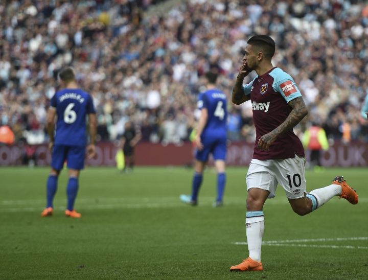 West Ham United's Manuel Lanzini celebrates scoring his side's first goal of the game during the English Premier League soccer match between West Ham United and Everton, at the London Stadium, in London, Sunday May 13, 2018. (Daniel Hambury/PA via AP)