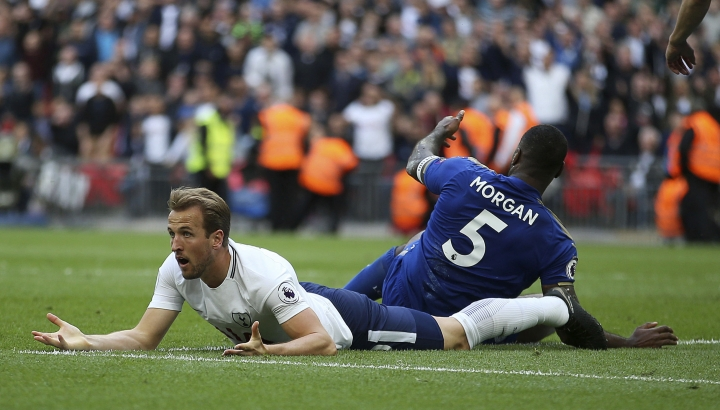 Tottenham Hotspur's Harry Kane, reacts after a tackle by Leicester City's Wes Morgan, during the English Premier League soccer match between Tottenham Hotspur and Leicester City, at Wembley Stadium, in London, Sunday May 13, 2018. (Steven Paston/PA via AP)