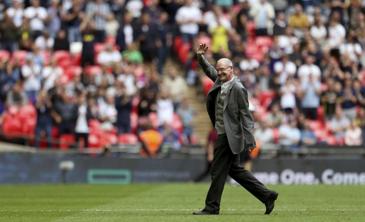 Former Tottenham Hotspur player Paul Gascoigne makes an appearance at half time during the English Premier League soccer match between Tottenham Hotspur and Leicester City, at Wembley Stadium, in London, Sunday May 13, 2018. (Steven Paston/PA via AP)