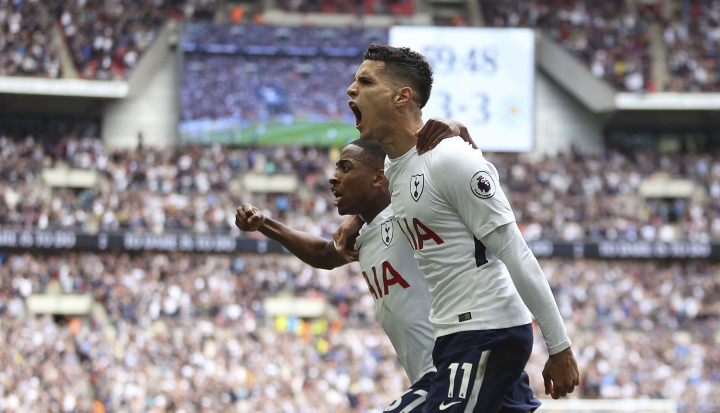 Tottenham Hotspur's Erik Lamela celebrates scoring his side's forth goal of the game with teammate Danny Rose during the English Premier League soccer match between Tottenham Hotspur and Leicester City, at Wembley Stadium, in London, Sunday May 13, 2018. (Steven Paston/PA via AP)