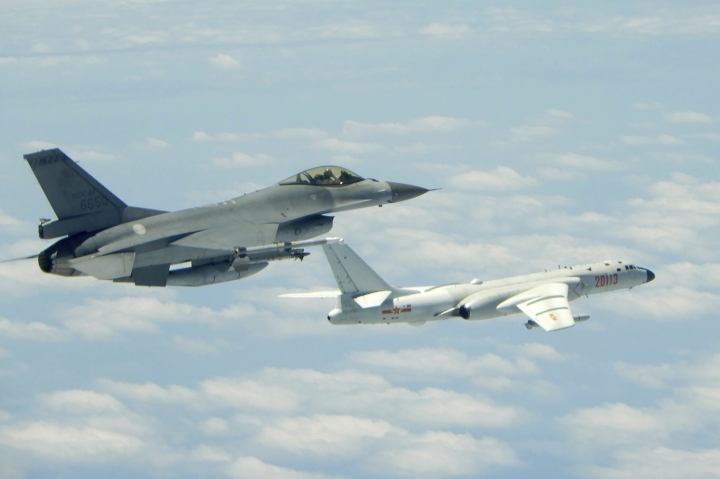 In this May 11, 2018 photo released by Taiwan's Ministry of National Defense, a Taiwanese Air Force fighter aircraft, left, flies near a Chinese People's Liberation Army Air Force (PLAAF) H6-K bomber that reportedly flew over the Luzon Strait south of Taiwan during an exercise. Taiwan is seeking to build-up its domestic defense industry in the face of China's threats and the reluctance of foreign arms suppliers to provide it with planes, ships, submarines and other hardware to defend its 23 million people. (Ministry of National Defense via AP)