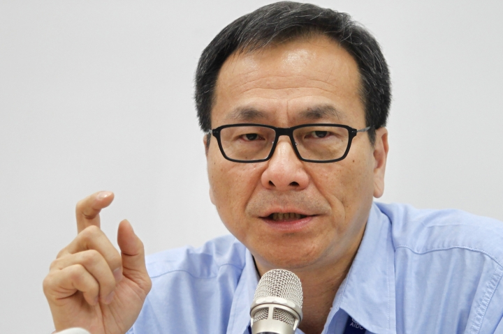 In this April 25, 2018 photo, Lin Nan-juh, the president of Aerospace Industrial Development Corp. (AIDC), speaks during a media event in Taichung, Taiwan. Standing on his company's sprawling campus in central Taiwan, Lin said he's able to make any plane his island's threatened government calls for. Taiwan is seeking to build-up its domestic defense industry in the face of China's threats and the reluctance of foreign arms suppliers to provide it with planes, ships, submarines and other hardware to defend its 23 million people. (AP Photo/Chiang Ying-ying)