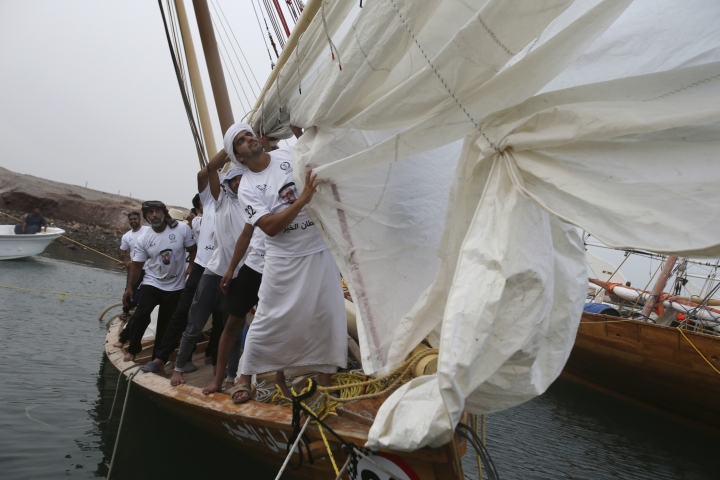 In this Sunday, May 13, 2018 photo, sailors prepare their boat a day ahead of the Al Gaffal traditional Dhow Race at the island of Sir Bu Nair about 100 kms (66 miles) west of Dubai, United Arab Emirates, Monday, May 14, 2018. (AP Photo/Kamran Jebreili)