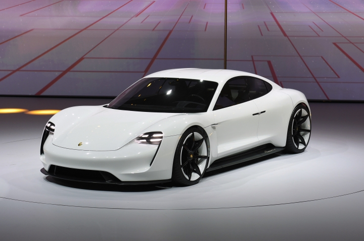FILE - In this Monday, Sept. 14, 2015 file photo, a Porsche Mission E is presented during the Volkswagen group night on the eve of the Frankfurt Auto Show IAA in Frankfurt, Germany. Charging an electric car away from home can be an exercise in uncertainty - hunting for that one lonely station at the back of a rest-area parking lot and hoping it's working. In Europe, some of the region's biggest automakers are out to remove the anxiety from the electric car consumer experience and help unleash an upswing in sales of electric vehicles by building a highway network of fast charging stations. Much is at stake for the automakers, which include Volkswagen, BMW, Daimler and Ford. Their joint venture, Munich-based Ionity, is pushing to roll out its network in time to service the next generation of battery-only cars coming on the market starting next year from Porsche, Audi, BMW and Daimler. (AP Photo/Jens Meyer, file)