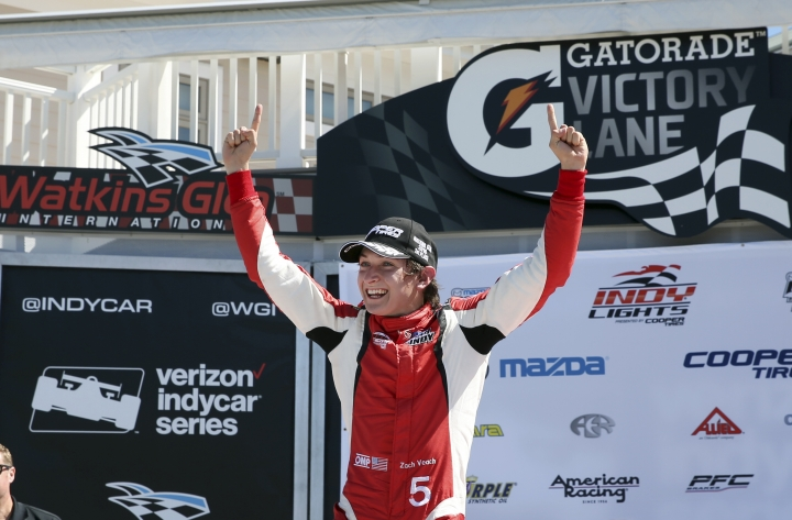 FILE - In this Sept. 3, 2016, file photo, Zach Veach (5) celebrates in Victory Lane after winning an Indy Lights auto race at The Glen in Watkins Glen, N.Y. Twenty-three-year-old Veach looks like the perfect guy for IndyCar's youth movement. He has a solid resume. He has a full-time ride with one of the series' top team. He has stable sponsorship and what appears to be a bright future. He understands the crucial art of building doing business, and in his first full-time season, he sounds like a veteran. If Veach succeeds, he could become a cornerstone for open-wheel's next generation of stars. (AP Photo/Mel Evans, File)