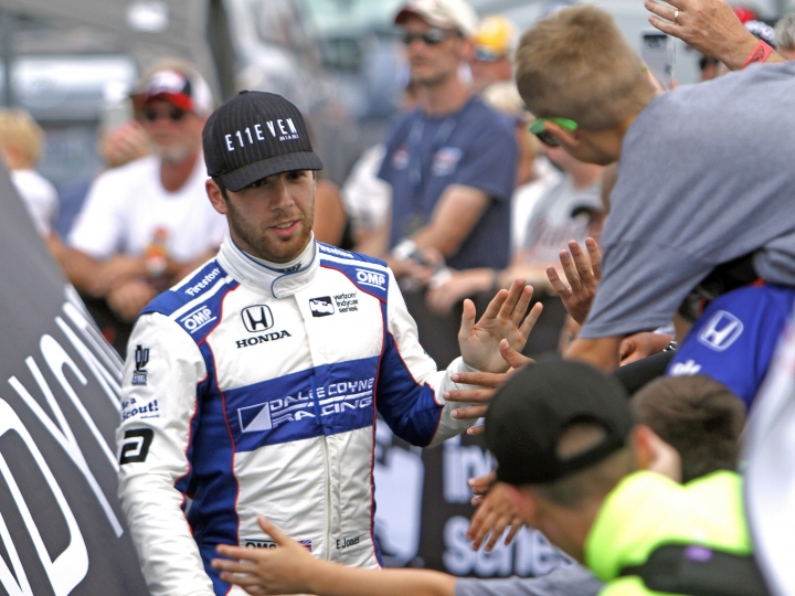 FILE - In this July 30, 2017, file photo, Ed Jones greets fans during driver introductions for the IndyCar auto race at Mid-Ohio Sports Car Course in Lexington, Ohio. It's possible more than 20 percent of this year's Indianapolis 500 starters could be, like Zach Veach, younger than 25. The class is rich in diversity and talent. Jones, the 23-year-old from Dubai who was last year's rookie of the year, drives for powerhouse team Chip Ganassi Racing. (AP Photo/Tom E. Puskar, File)