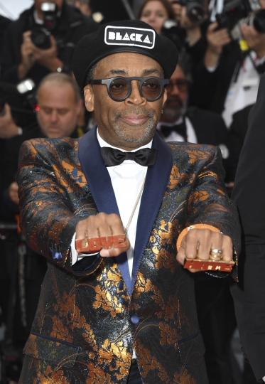 Director Spike Lee poses for photographers upon arrival at the premiere of the film 'BlacKkKlansman' at the 71st international film festival, Cannes, southern France, Monday, May 14, 2018. (Photo by Arthur Mola/Invision/AP)