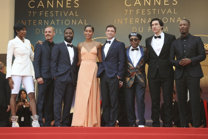 Actors Damaris Lewis, from left, Jasper Paakkonen, John David Washington, Laura Harrier, Topher Grace, director Spike Lee, actors Adam Driver, and Corey Hawkins pose for photographers upon arrival at the premiere of the film 'BlacKkKlansman' at the 71st international film festival, Cannes, southern France, Monday, May 14, 2018. (Photo by Joel C Ryan/Invision/AP)