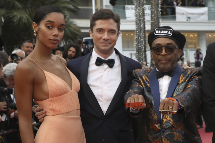 Actors Laura Harrier, from left, Topher Grace, and director Spike Lee pose for photographers upon arrival at the premiere of the film 'BlacKkKlansman' at the 71st international film festival, Cannes, southern France, Monday, May 14, 2018. (Photo by Vianney Le Caer/Invision/AP)