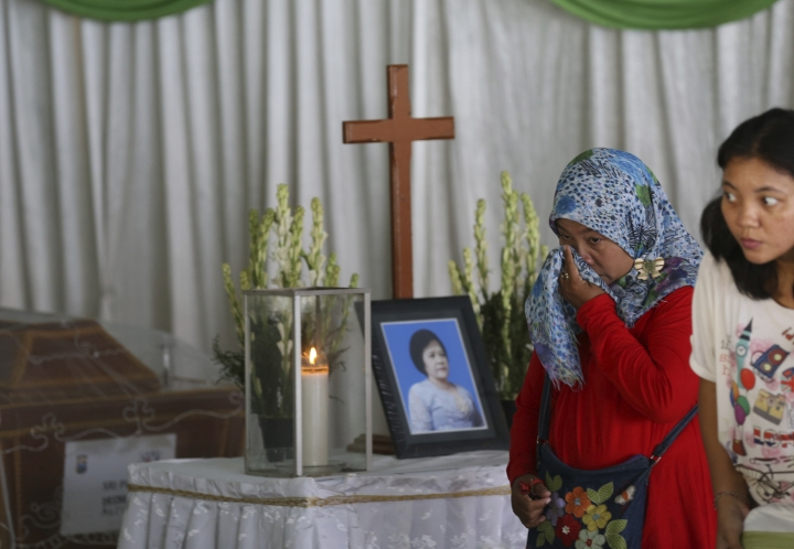 A Muslim woman weeps during the wake for Sri Pudji Astutik, one of the victims of Sunday's church attacks, at a funeral home in Surabaya, East Java, Indonesia, Monday, May 14, 2018. The flurry of bombings raised concerns that previously beaten-down militant networks in the world's most populous Muslim-majority nation have been reinvigorated by the return of some of the estimated 1,100 Indonesians who went to fight with the Islamic State group in Syria. Experts have warned for several years that when those fighters return, they could pose a significant threat. (AP Photo/Achmad Ibrahim)
