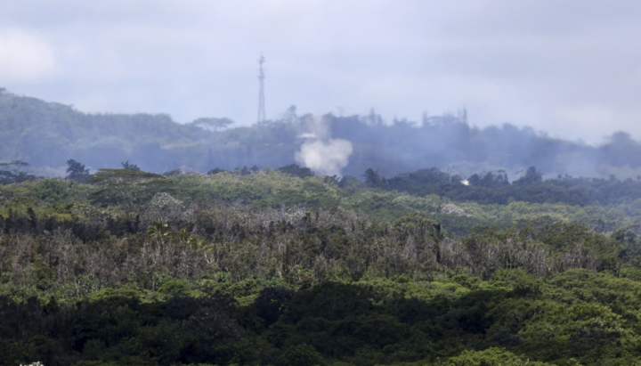 Volcanic gases and ash rise from recent lava fissures near Pahoa, Hawaii on Monday, May 14, 2018. People nixing vacations to Hawaii's Big island has cost the tourism industry millions of dollars as the top attraction, Kilauea volcano, keeps spewing lava. (AP Photo/Caleb Jones)