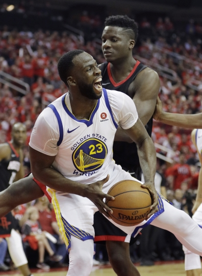 Golden State Warriors forward Draymond Green (23) pulls down a rebound against the Houston Rockets during the second half of Game 1 of the NBA basketball Western Conference Finals, Monday, May 14, 2018, in Houston. (AP Photo/David J. Phillip)