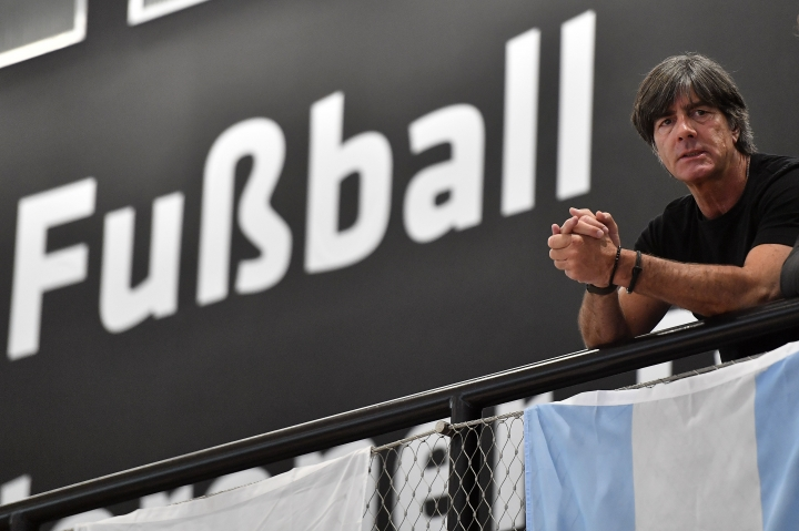Germany's head coach Joachim Loew watches from the gallery prior the presentation of Germany's team for the soccer World Cup in Russia on Tuesday, May, 15, 2018 in the German Football Museum in Dortmund, Germany. (AP Photo/Martin Meissner)